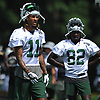 Robby Anderson #11, left, and Lucky Whitehead #82 (in background) of the New York Jets lift their helmets to cool off during team practice at the Atlantic Health Jets Training Center in Florham Park, NJ on Saturday, July 28, 2018.