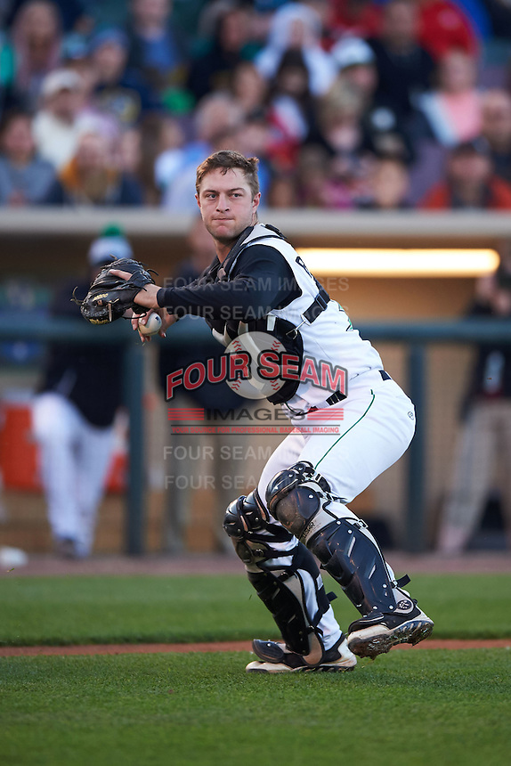 Dayton Dragons catcher Garrett Boulware (30) throws to first during a game against the Great Lakes Loons on May 21, 2015 at Fifth Third Field in Dayton, Ohio.  Great Lakes defeated Dayton 4-3.  (Mike Janes/Four Seam Images)