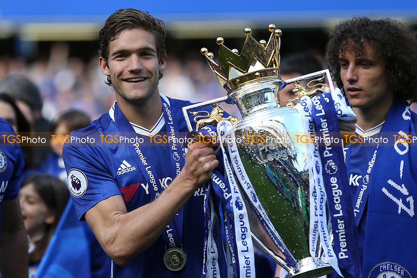 Chelsea's Marcos Alonso holds the Premier League Trophy as he celebrates winning the Premier League during Chelsea vs Sunderland AFC, Premier League Football at Stamford Bridge on 21st May 2017