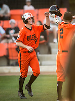 Huntington Beach Oilers Jake Vogel (27) celebrates with teammates after scoring a run during a High School baseball game on February 26, 2020 in Studio City, California.  (Terry Jack/Four Seam Images)
