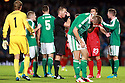 SERIES OF THREE IMAGES  Northern Ireland's Gareth McAuley checks his head after Portugal's  Helder Postiga head butt, earning Postiga a red card and being sent off during the first half a World Cup Qualifier in Belfast, Friday September 6th, 2013.  Photo/Paul McErlane