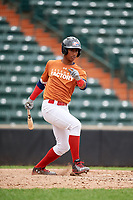 Luis De La Cruz (11) follows through on a swing during the Dominican Prospect League Elite Underclass International Series, powered by Baseball Factory, on July 21, 2018 at Schaumburg Boomers Stadium in Schaumburg, Illinois.  (Mike Janes/Four Seam Images)