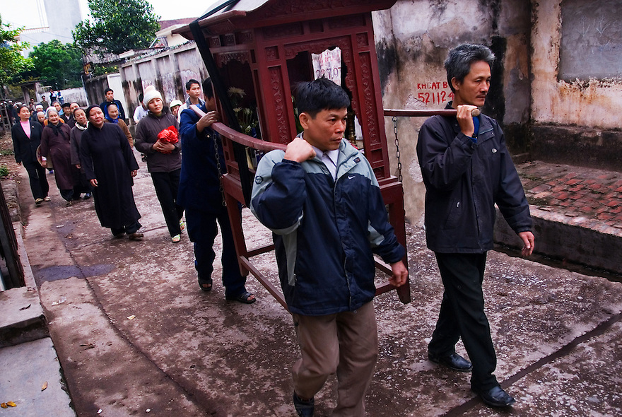 A funeral processes down Lang Cu Da in Hanoi, Vietnam.