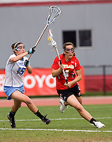Kara Cannizzaro (15) of North Carolina tries to stop Brandi Jones (4) of Maryland during the ACC women's lacrosse tournament finals in College Park, MD.  Maryland defeated North Carolina, 10-5.