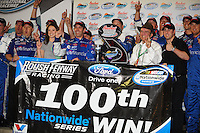 Apr 17, 2009; Avondale, AZ, USA; NASCAR Nationwide Series driver Greg Biffle and car owner Jack Roush celebrate after winning the Bashas Supermarkets 200 at Phoenix International Raceway. The win was the 100th Nationwide Series win for Jack Roush. Mandatory Credit: Mark J. Rebilas-