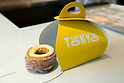 The Cronut on display during the pre-opening event for the new pastry shop ''Dominique Ansel Bakery'' in Omotesando Hills on June 17, 2015, Tokyo, Japan. The new brand is known for its Cronuts pastry; a croissant doughnut fusion creation by Chef Dominique Ansel and is already hugely popular in New York. This is the first time that it will open an international branch. Japan has seen a recent boom in international food retailers especially trying to become the latest new trend in Tokyo. The store opens its doors to the public on June 20th and long lines are expected. (Photo by Rodrigo Reyes Marin/AFLO)