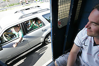 Mexican fans in a car give a thumbs up to United States fans who were placed on a  Mexican police transport bus leaving Azteca Stadium under a police escort. Mexican police officers in riot gear separated the team's fan supporters to prevent any violence and fearing for the fan's safety, Mexican police transported the United States fans to a different subway stop to travel back to their hotels. The United States Men's National Team played Mexico in a CONCACAF World Cup Qualifier match at Azteca Stadium in, Mexico City, Mexico on Wednesday, August 12, 2009.