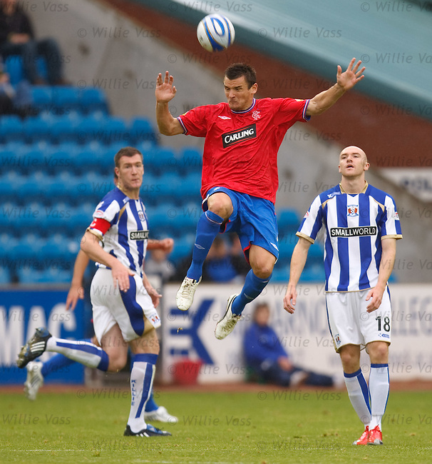 Lee McCulloch heads clear