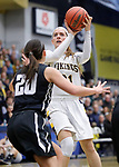 SIOUX FALLS, SD: MARCH 12:  Hannah Mitby #21 of Augustana shoots over Central Missouri defender Megan Skaggs #20 during the 2018 NCAA Division II Women's Basketball Central Region Championship Monday at the Elmen Center in Sioux Falls, S.D. (Photo by DIck Carlson/Inertia)