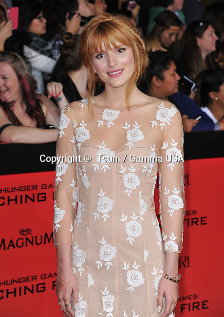Bella Thorne arriving at the The Hunger Games- Catching Fire Premiere at the Nokia Theatre In Los Angeles.