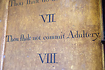Historic interior of Saint John the Baptist church, Mildenhall, Wiltshire, England, UK 'Thou shalt not commit adultery' commandment