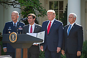 """From left to right: General John W. """"Jay"""" Raymond, Commander, Air Force Space Command, United States Secretary of Defense Dr. Mark T. Esper, US President Donald J. Trump, and US Vice President Mike Pence pose with the proclamation establishing the US Space Command in the Rose Garden of the White House in Washington, DC on Thursday, August 29, 2019.  The Space Command will be the lead military agency for the planning and execution of space operations and will be a step towards establishing a Space Force as a new military service.<br /> Credit: Ron Sachs / Pool via CNP"""