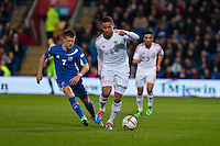 Wednesday 05 March 2014<br /> Pictured:  ( L-R) Johan Gudmunsson of Iceland chases Hai Robson kanu <br /> Re: International friendly Wales v Iceland at the Cardiff City Stadium, Cardiff,Wales UK