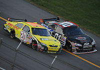 Oct 5, 2008; Talladega, AL, USA; NASCAR Sprint Cup Series driver Regan Smith (01) goes below the yellow line to pass Tony Stewart (20) on the last lap during the Amp Energy 500 at the Talladega Superspeedway. Smith crossed the finish line first but the win was given to Stewart because Smith went below the yellow line which is against the rules. Mandatory Credit: Mark J. Rebilas-