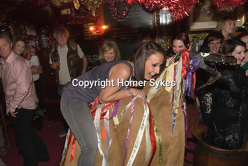 The Hooden Horse and Christmas reveler. Sandgate Hoodeners at the the Ship Inn, Sandgate, Nr Folkstone Kent. UK.
