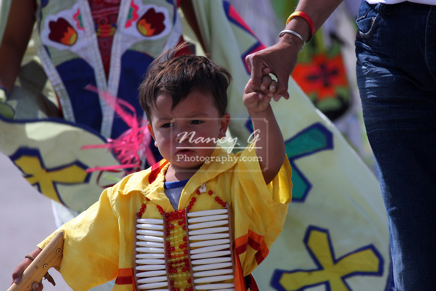 A Native American Indian boy dancer at a Pow Wow at the Milwaukee Lakefront Indian Summer Festival, Wisconsin