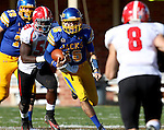 BROOKINGS, SD - OCTOBER 25:  Zach Lujan #16 from South Dakota State University runs for a first down between Terrell Williams #59 and Donald D'Alesio #8 from Youngstown State in the second quarter of their game Saturday afternoon at Coughlin Alumni Stadium in Brookings. (Photo by Dave Eggen/Inertia)