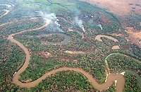 A tributary of the Paraguay river winds through the hazy, smoke-filled skies of the Pantanal Mato Grossense wetland during the fire-prone dry season. The wetland, half the size of France, supports one of the most intact arrays of wildlife in the world, despite 200 years of cattle ranching. Subdivision of properties in the region weaken the economic viability of the traditional ranches.