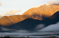 Mountain sunrise and valley fog, Arthurs Pass, New Zealand