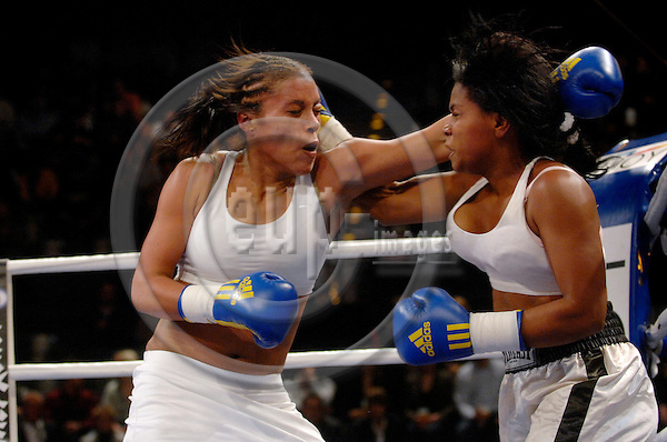 BERLIN - GERMANY 26 JAN 2008 -- Norwegian Cecilia BRAEKHUS (L) won her jr. welterweight fight against Wanda Pena OZUNA from the Dominican Republic during a boxing event in Berlin on Saturday, Jan. 26, 2008. The match was the first one for BRAEKHUS for the German Sauerland team..-- PHOTO: © GORM K. GAARE/ EUP-BERLIN