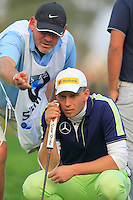 Marcel Siem (GER) and caddy Guy Tilston line up his putt at the 18th green during Sunday's Final Round of the 2014 BMW Masters held at Lake Malaren, Shanghai, China. 2nd November 2014.<br />