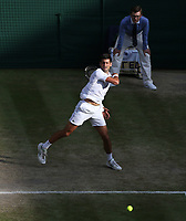 Novak Djokovic (SRB) during his match against Roger Federer (SUI) in their Gentleman's Singles Final match<br /> <br /> <br /> Photographer Rob Newell/CameraSport<br /> <br /> Wimbledon Lawn Tennis Championships - Day 13 - Sunday 14th July 2019 -  All England Lawn Tennis and Croquet Club - Wimbledon - London - England<br /> <br /> World Copyright © 2019 CameraSport. All rights reserved. 43 Linden Ave. Countesthorpe. Leicester. England. LE8 5PG - Tel: +44 (0) 116 277 4147 - admin@camerasport.com - www.camerasport.com