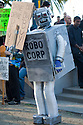"Person in Robo Corp robot costume with ""Drive... Buy..."" sign (concepts: driving, consumerism, consumption, materialism, corporations, capitalism). Hundreds of people gathered in downtown San Francisco for 350.org's International Day of Climate Action, October 24, 2009. Greenpeace, Mobilization for Climate Justice, and many others helped put on the local event. California, USA"