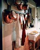 ITALY, Verona, kitchen utensils with clothes hung in kitchen of Ristorante Groto De Corgnan.