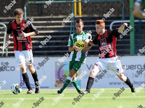 2012-08-12 / Voetbal / seizoen 2012-2013 / Racing Mechelen - Beringen / Laurent Megan (l. RCM) met Senne Poelmans..Foto: Mpics.be