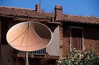 TV dish on a rooftop, Gardanne, Provence, France.