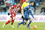Getafe's Victor Rodriguez (r) and Atletico de Madrid's Koke Resurrecccion during La Liga match. February 14,2016. (ALTERPHOTOS/Acero)