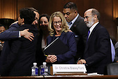 WASHINGTON, DC - SEPTEMBER 27:  Christine Blasey Ford (C) is surrounded by her attorney Michael Bromwich (R), supporters and security agents after she testified before the Senate Judiciary Committee in the Dirksen Senate Office Building on Capitol Hill September 27, 2018 in Washington, DC. A professor at Palo Alto University and a research psychologist at the Stanford University School of Medicine, Ford has accused Supreme Court nominee Judge Brett Kavanaugh of sexually assaulting her during a party in 1982 when they were high school students in suburban Maryland.  (Photo by Win McNamee/Getty Images)