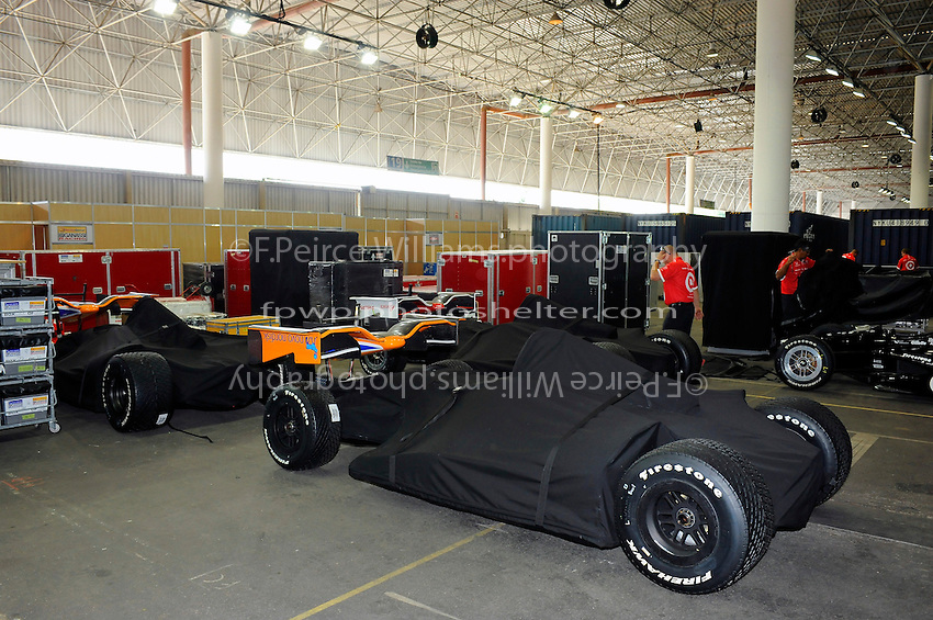 The unpacking of the air freighted cars and supplies in the paddock