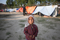 A child  earthquake survivor in a makeshift  shelter camp at Bhaktapur, near Kathmandu, Nepal.  May 03, 2015