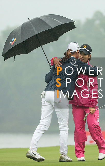 Seung Hyun Lee of South Korea (right) hugs Min Sun Kim of South Korea (left) at the end of their game at the 18th hole during Round 4 of the World Ladies Championship 2016 on 13 March 2016 at Mission Hills Olazabal Golf Course in Dongguan, China. Photo by Victor Fraile / Power Sport Images