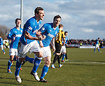 Lee McCulloch celebrates after stroking away the added on time penalty to win the game for Rangers