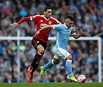Sergio Aguero of Manchester City held back by Chris Smalling of Manchester United during the Barclays Premier League match at The Etihad Stadium. Photo credit should read: Simon Bellis/Sportimage