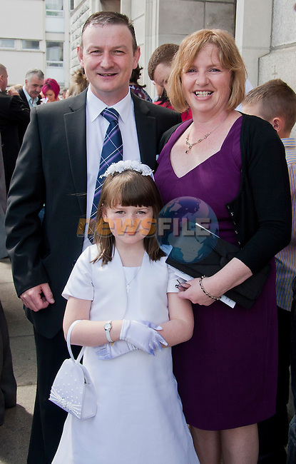 Martin Gray and Claire Gray with Marrie Gray who made her communion..Picture: Shane Maguire / www.newsfile.ie.