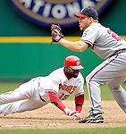 17 May 2007: Washington Nationals infielder Cristian Guzman dives safely back to first against the Atlanta Braves at RFK Stadium in Washington, DC. The Nationals defeated the Braves 4-3 to take the four-game series three games to one...Mandatory Photo Credit: Ed Wolfstein Photo