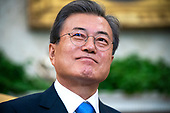 Korean President Moon Jae-in listens to US President Donald J. Trump (not pictured) speak in the Oval Office of the White House in Washington, DC, USA, 11 April 2019. President Moon is expected to ask President Trump to reduce sanctions on North Korea in an attempt to jump start nuclear negotiations between North Korea and the US.<br /> Credit: Jim LoScalzo / Pool via CNP