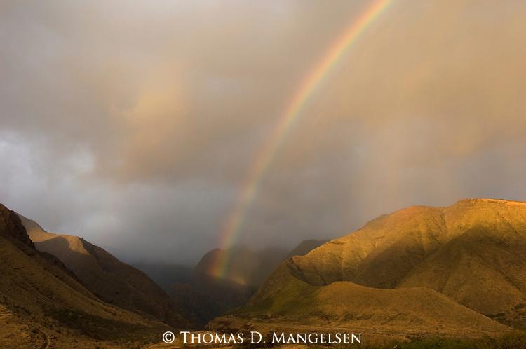 Rainbow above the mountains of Maui, Hawaii.