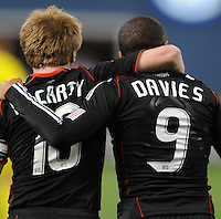 DC United forward Charlie Davies (9) celebrates his second goal of the game with teammate Dax McCarty (10)  DC United defeated The Columbus Crew 3-1  at the home season opener, at RFK Stadium, Saturday March 19, 2011.