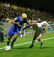 Milton Keynes' Alex Gilbey loses out to AFC Wimbledon's Lyle Taylor during the Sky Bet League 1 match between AFC Wimbledon and MK Dons at the Cherry Red Records Stadium, Kingston, England on 22 September 2017. Photo by Carlton Myrie / PRiME Media Images.