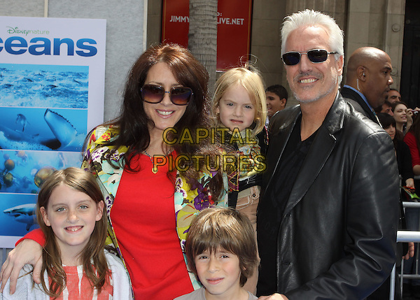 """JOELY FISHER & CHRIS DUDDY .Arrivals - Disneynature's Premiere Of """"Oceans"""" held At El Caitan Theatre,  Hollywood, California, USA, .17th April 2010..half length father family mother husband wife couple kids children son daughters sunglasses red top leather black jacket .CAP/ADM/KB.©Kevan Brooks/AdMedia/Capital Pictures"""