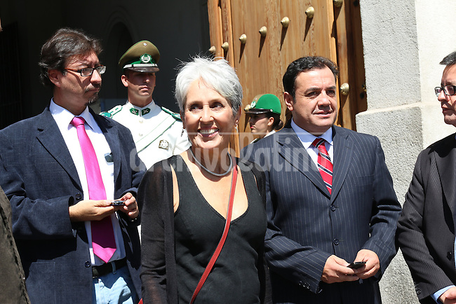 American singer Joan Baez leaves La Moneda Presdiential Palace after her meeting with President of Chile Michelle Bachelet , during her first day in office in Santiago, Chile