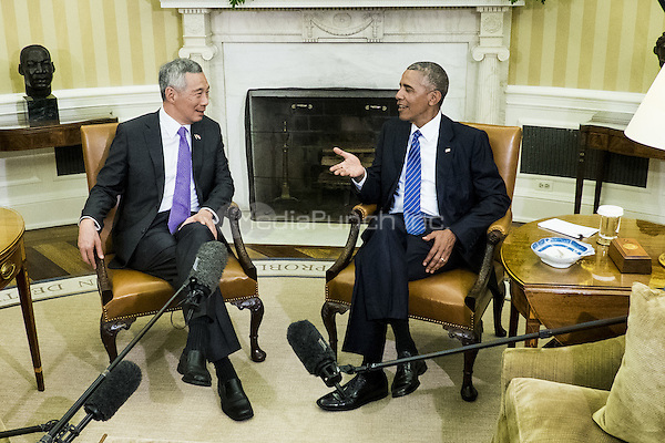 Prime Minister Lee Hsien Loong of Singapore and United States President Barack Obama meet in the Oval Office following a State Welcome Ceremony on the South Lawn of the White House in Washington, DC on August 2, 2016. Lee is on a State Visit to the United States.   <br /> Credit: Pete Marovich / Pool via CNP/MediaPunch