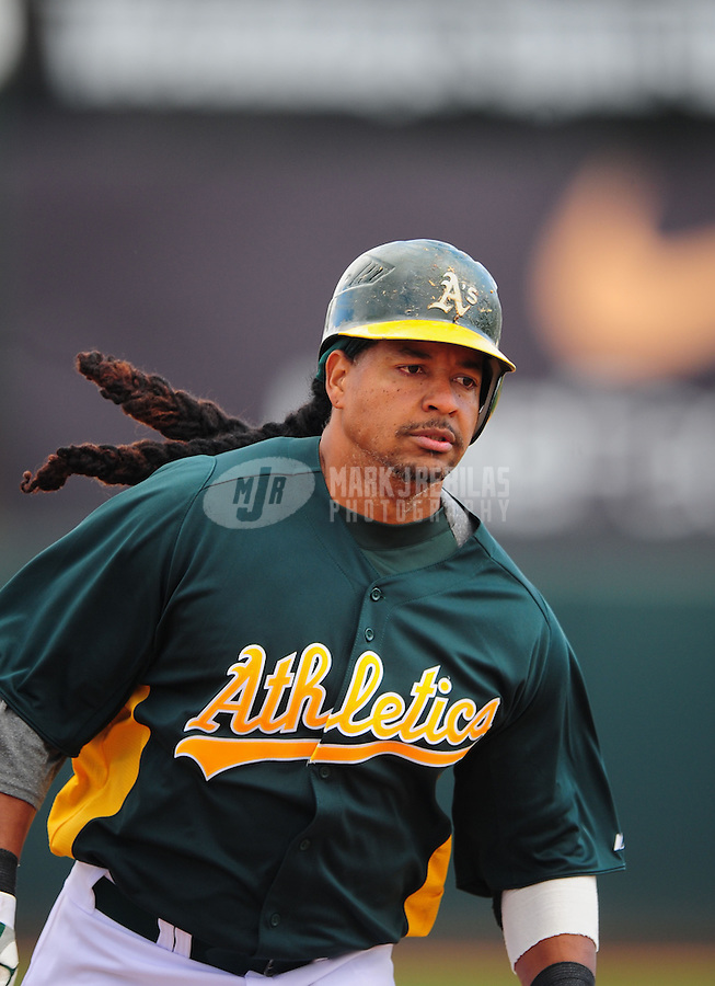 Mar. 19, 2012; Phoenix, AZ, USA; Oakland Athletics designated hitter Manny Ramirez rounds the bases after hitting a solo home run in the third inning against the Arizona Diamondbacks during a spring training game at Phoenix Municipal Stadium.  Mandatory Credit: Mark J. Rebilas-