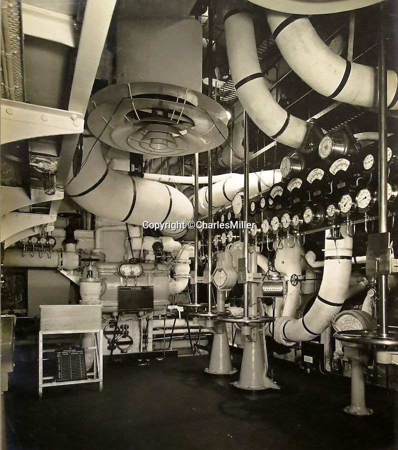 BNPS.co.uk (01202 558833)<br /> Pic: CharlesMiller/BNPS<br /> <br /> Engine room.<br /> <br /> Photo album documents the birth of the RMS Queen Mary - Britain's glamorous transatlantic flagship from the Golden Age of steam.<br /> <br /> The unique album of photographs were presented to Sir John Stewart, Provost of Glasgow in 1937, and detail the historic construction, launch and fitting out of the famous ship.<br /> <br /> Built by John Brown's on the Clyde the historic ship sailed on her maiden transatlantic voyage on 27 May 1936 and captured the Blue Riband in August of that year.<br /> <br /> The ship became a byword for luxury and glamour on the prestigious route from Southampton to New York, remaining in service until 1967, when she was retired to become a floating hotel in Long Beach, California.
