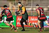 Cameron Skelton makes a telling run downfield. Counties Manukau Premier Club Rugby game between Pukekohe and Papakura, played at Colin Lawrie Fields Pukekohe on Saturday June 9th 2018. Pukekohe won the game 37 - 22 after leading 15 - 10 at halftime. <br /> Photo by Richard Spranger.