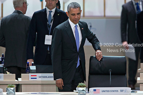 """United States President Barack Obama arrives during an opening plenary entitled """"National Actions to Enhance Nuclear Security"""" at the Nuclear Security Summit in Washington, D.C., U.S., on Friday, April 1, 2016. After a spate of terrorist attacks from Europe to Africa, Obama is rallying international support during the summit for an effort to keep Islamic State and similar groups from obtaining nuclear material and other weapons of mass destruction. <br /> Credit: Andrew Harrer / Pool via CNP"""